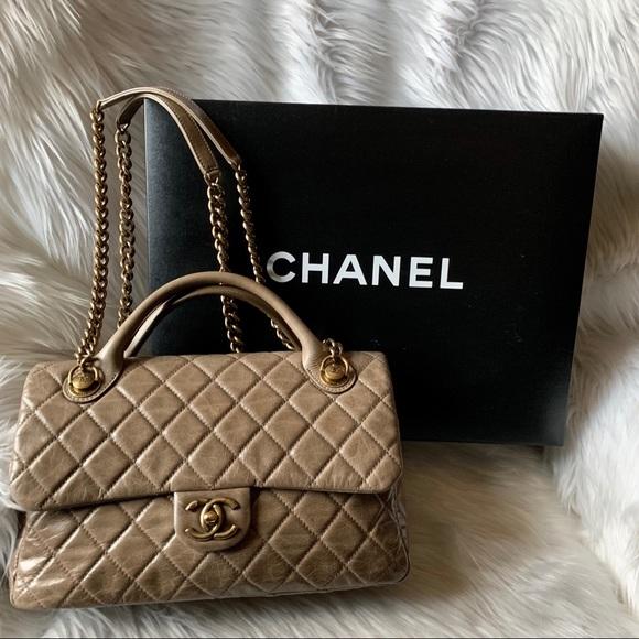 1567c04dbdfa CHANEL Bags | Glazed Calfskin Castle Rock Top Handle Bag | Poshmark